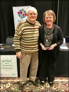 JP and Gloria Leffman holding featured foster parent award