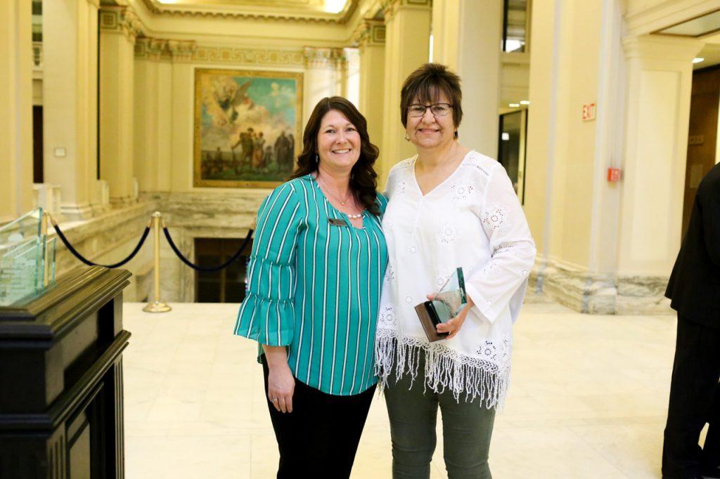 donna keller with DCCCA Tallgrass employee Lori Bichelmeyer posing for a photo