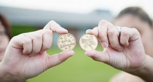 "Two hands, each holding up a recovery coin that reads ""I am a Miracle"""